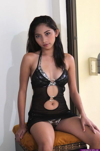 Asian beauty removes dress and lingerie to model naked for first time