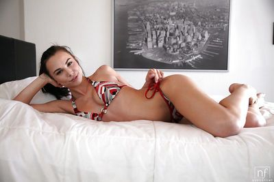 Beautiful petite brunette Aidra Fox showing off her tiny tits