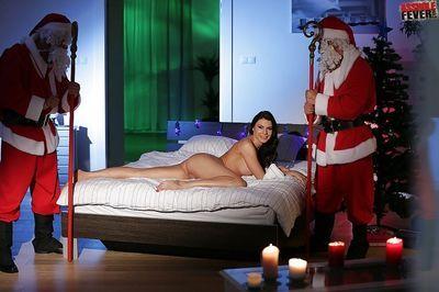 Kitana Lure gives a pair of Santas blowjobs for holiday gift