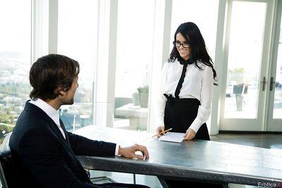 Glasses adorned brunette pornstar Megan Rain taking hardcore sex in office