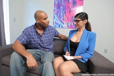 Clothed girl Mia Khalifa sucks BBC & gets cum on tits in hot interracial fuck