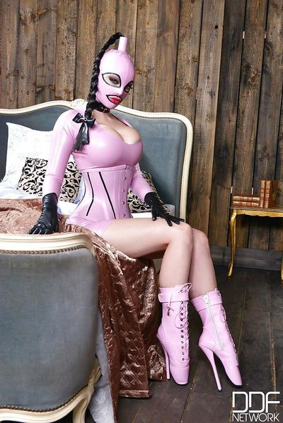 Top fetish model Latex Lucy posing in her latest kinky uniform