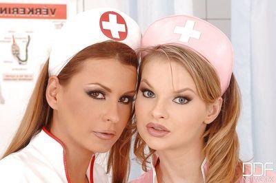 Busty lesbian MILFs Dorothy Black and Tarra White go tit to tit