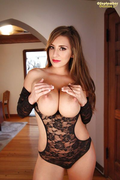 Luscious babe with big tits and tattoo September Carrino pets nipples