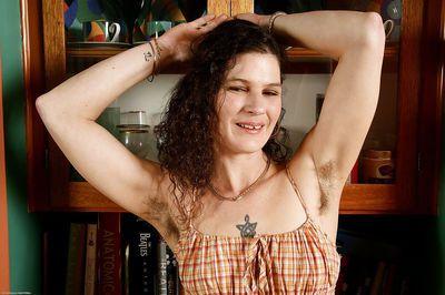 Older woman Sunshine baring hairy armpits and mature saggy breasts