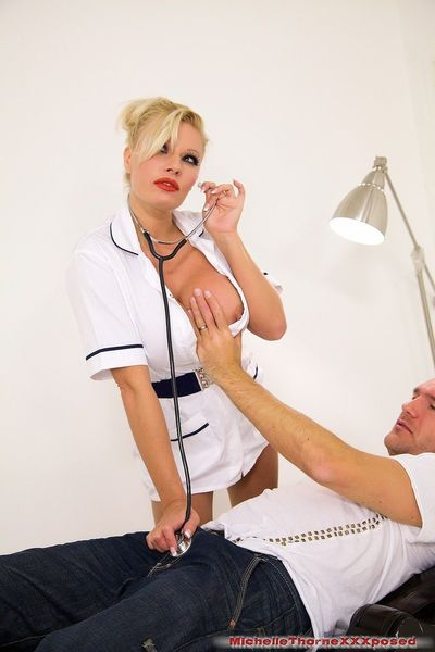 Busty blonde nurse Michelle Thorne jerks and rides her hospital patient