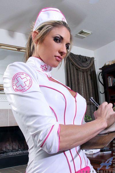 Sexy MILF freeing large tits from nurse uniform before masturbating