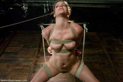 BDSM bitch Bobbi Starr got anally penetrated while hanging from the roof