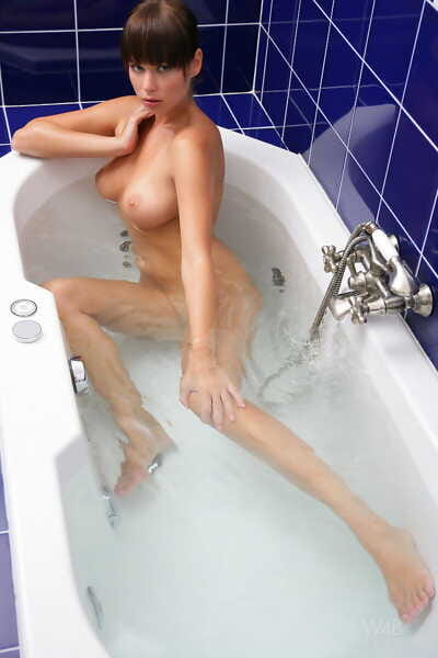 Striking erotic beauty Nina naked in the bath showing sexy feet & perky tits