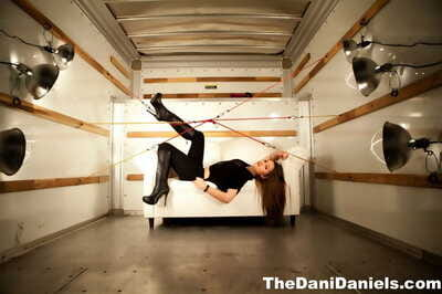 Solo girl Dani Daniels exposes her trimmed muff in back of a Uhaul truck