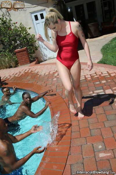 Blonde female Dahlia Sky lines black men up for interracial gangbang