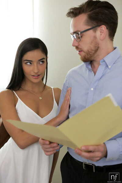 Sultry brunette Emily Willis seduces her realtor with a kiss in a white dress