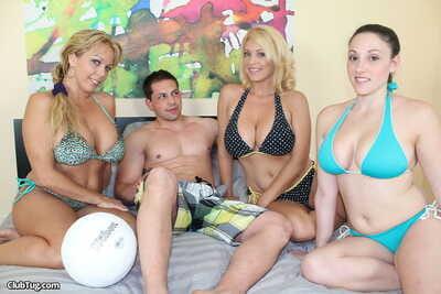 3 big boobed girls remove bikini tops while jerking a cock together