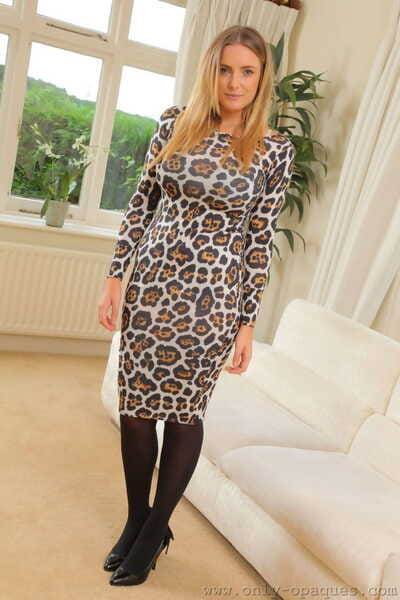 Curvy blonde wife Stacey M removes her leopard dress and unveils huge breasts