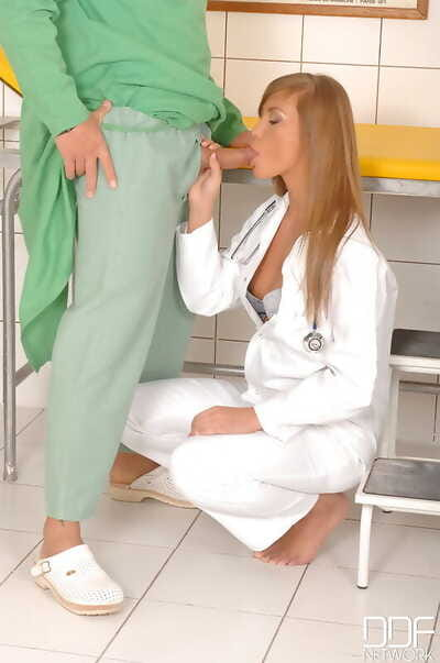 Beautiful nurse Jessika Lux takes the ball sac in her mouth during a blowjob