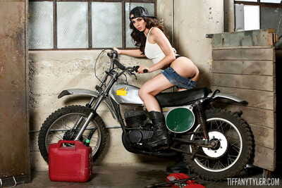 Hot brunette -Tiffany Tyler shows her tits and ass on vintage motorcycle