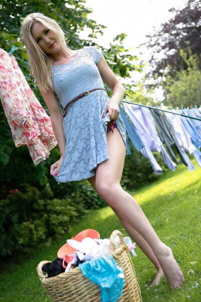 Hot blonde Sam Tye flashes panty upskirt hanging laundry & trips in the yard