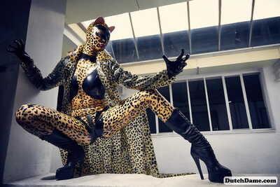Solo model strikes hot poses in full body leopard print costume