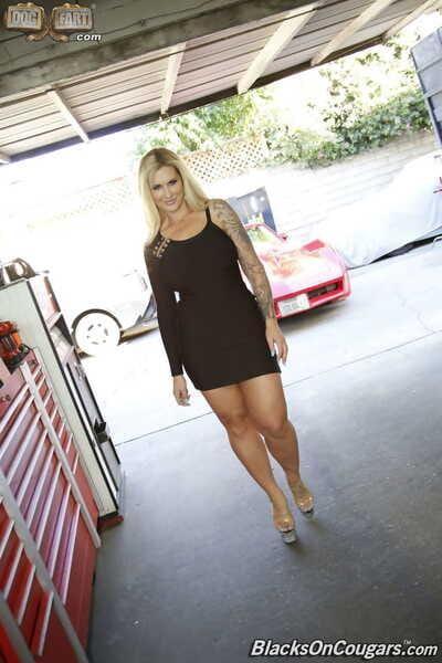 Curvy blonde female Ryan Conner walks in a bangs 2 black mechanics