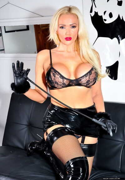 Hot blonde Lucy Zara uncups big boobs in latex skirt and matching OTK boots