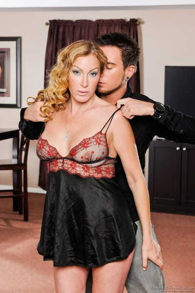 Hot cougar Randi James partakes in foreplay with toy boy in lingerie