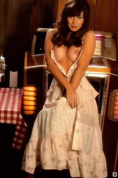 Erotic mature country Patti McGuire flaunts perfect big tits by the jukebox