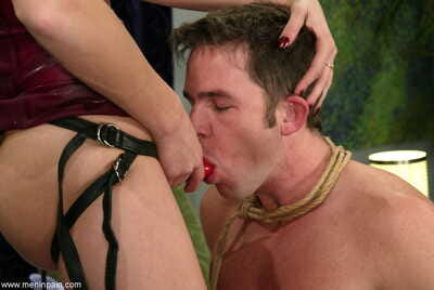 White female Audrey Leigh face fucks her male submissive before hot wax attack
