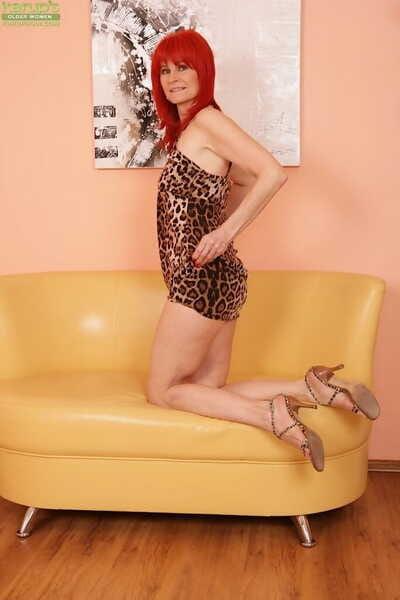 Leggy aged redhead Amanda Rose slips fingers into hairy bush in high heels