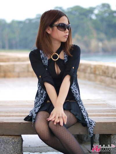 Pretty Japanese girl strips naked overlooking the ocean in heels