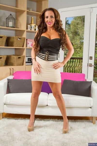 MILF Richelle Ryan shows her killer curves as she strips in the living room