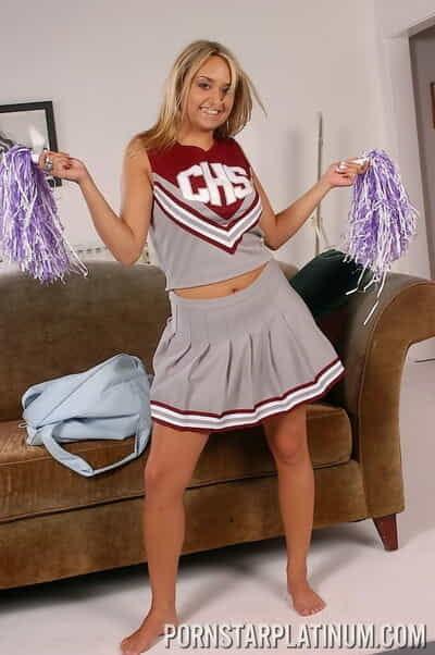 Cheerleader frees up her big natural tits prior to masturbating