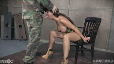 Restrained female Syren De Mer is forced to suck cock by a military man