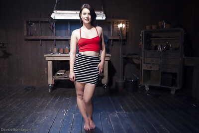 Brunette bondage model Katharine Cane taking painful pegging