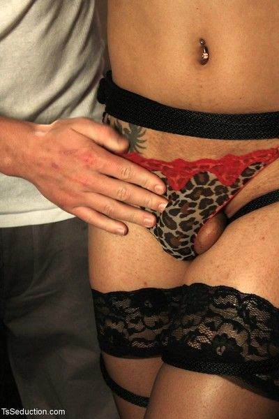 Tied up ts honey & her huge 10 in cock seduces her man. he unties her & she unle