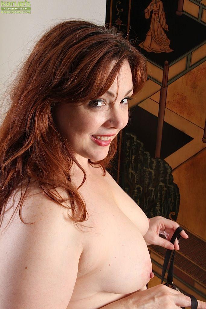 BBW Ember Rayne strips off pantyhose before masturbating hairy MILF pussy