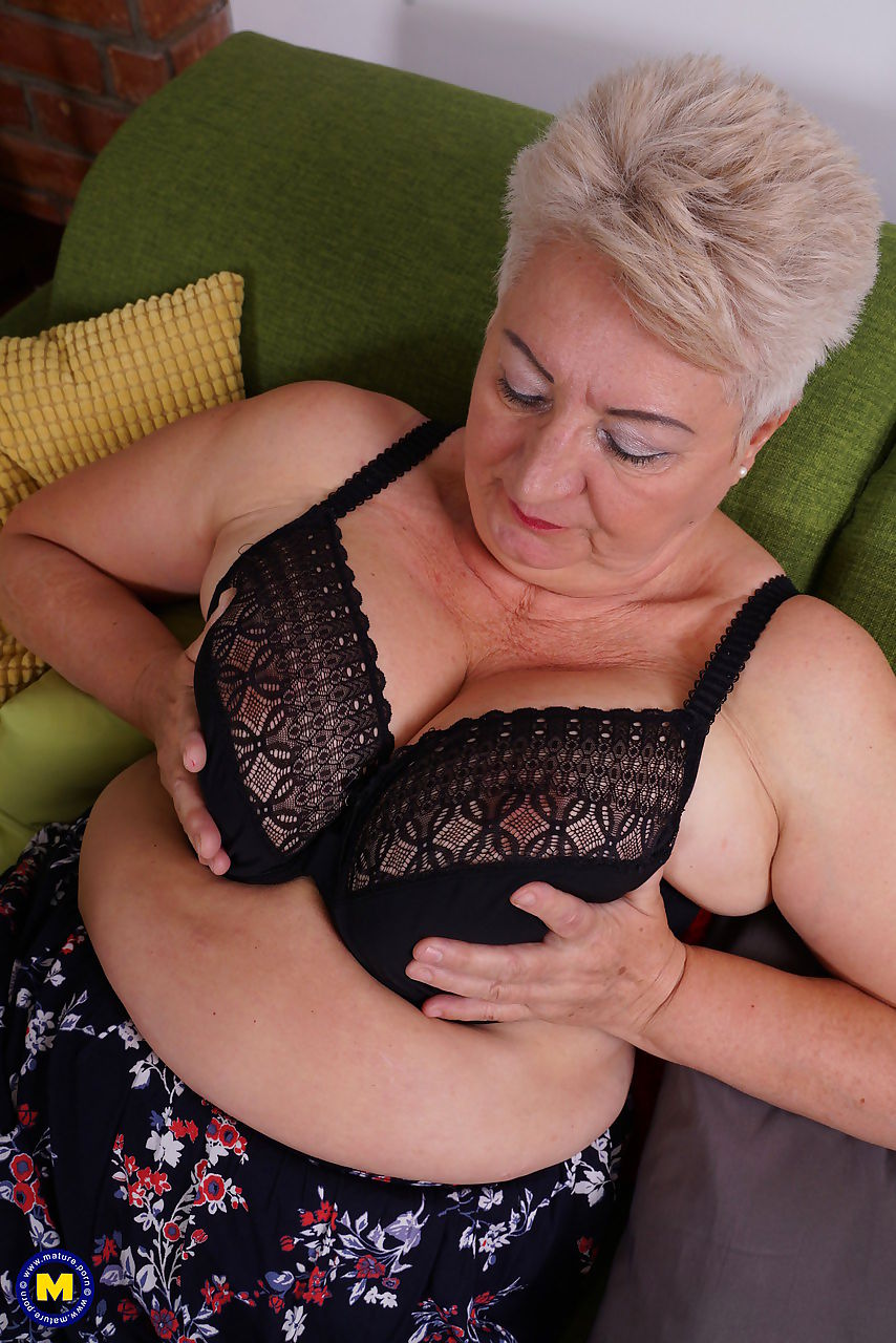 Fat grandmother strips down to black stockings before fingering her vagina