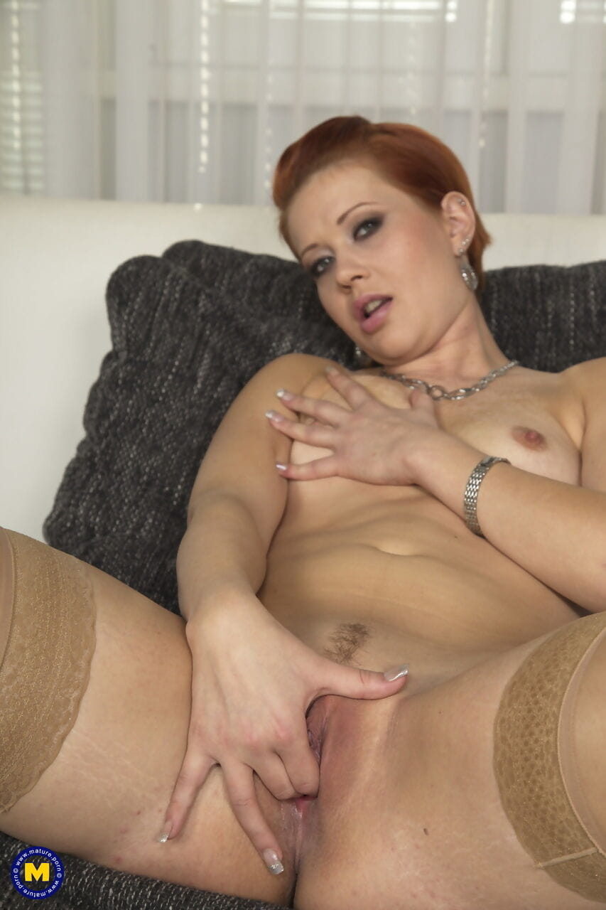 Red haired mom Lucy Da Light with tiny tits masturbating on the couch