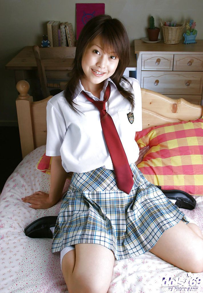 Naughty asian schoolgirl Ayumi Motomura slipping off her uniform