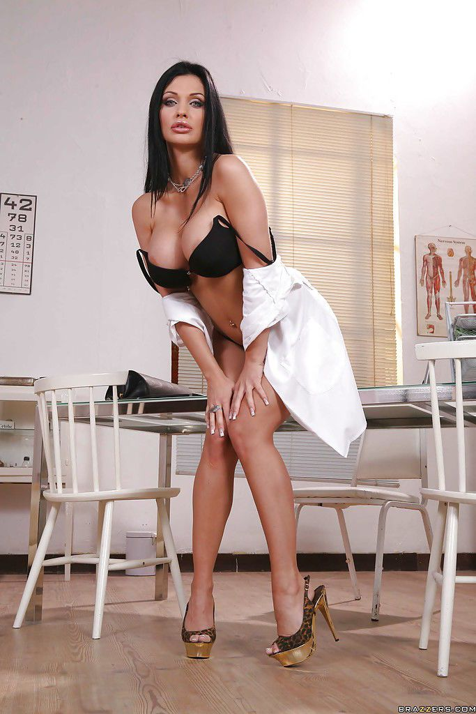 Busty doctor Aletta Ocean in uniform shows her perfect body