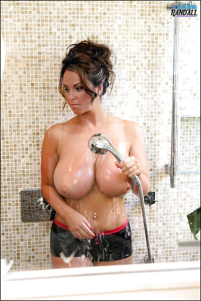 Big boobed babe Sarah Nicola Randall takes her huge hooters to the shower