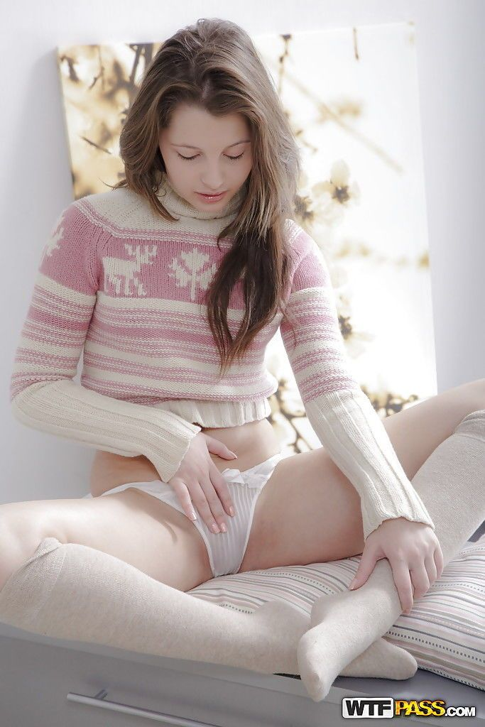 Sweet teen babe Juliya posing in little girl panties and exposing tits