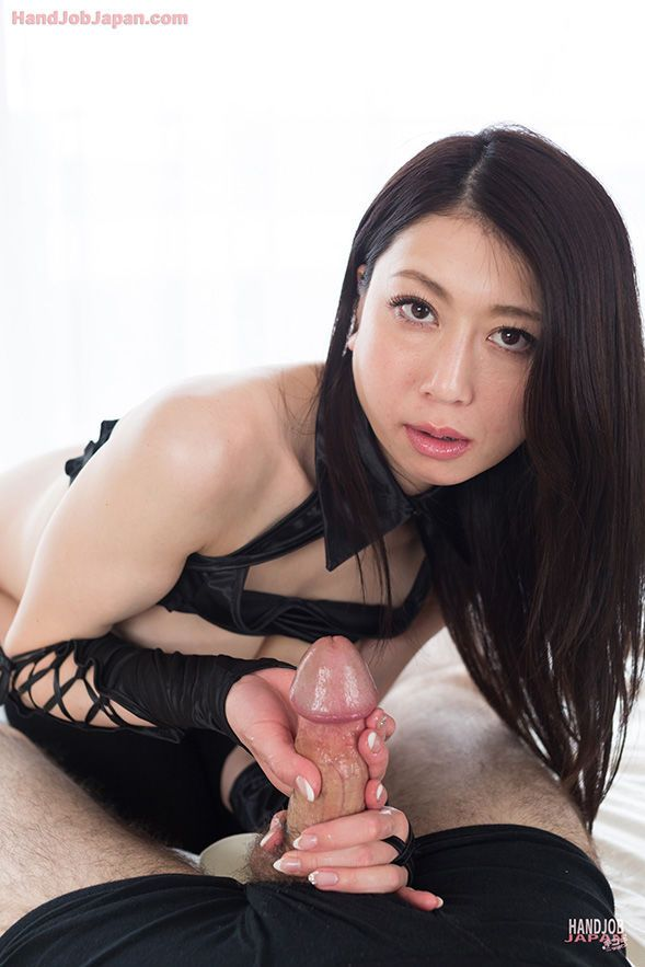 Japanese chick in thigh high socks & long gloves eats cum after giving handjob