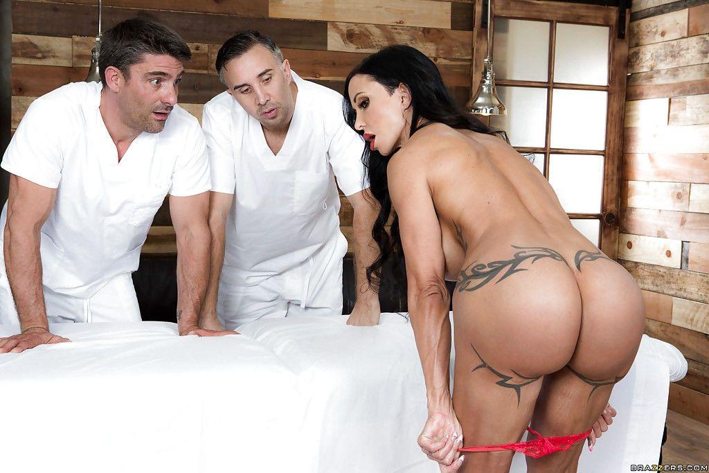 Busty brunette Jewels Jade sucking off 2 huge dicks after massage and anal sex