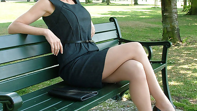 Clothed business woman shows off..