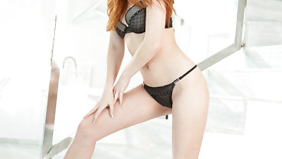 Red haired Denisa Heaven in black..