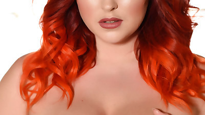 Fat redhead Lucy V uncovers her..