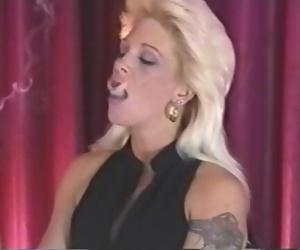 Sexy Mature Smoker Inhales Deeply