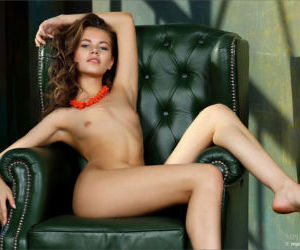 Gorgeous young slut drapes her sexy body over the chair to..