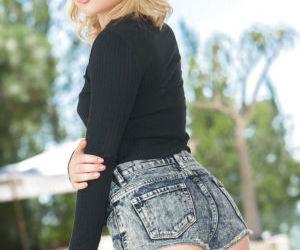 Hot blonde babe Dakota Skye poses in pink thong and shows..