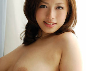 Adorable asian coed in lingerie showcasing her amazing..